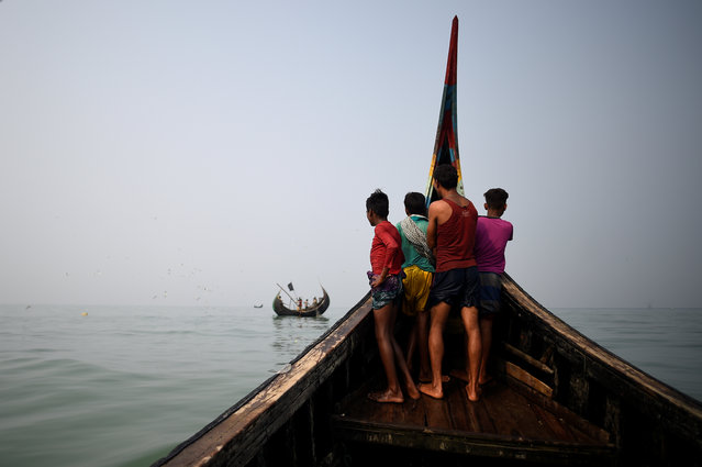 Rohingya refugees crew a fishing boat in the Bay of Bengal near Cox's Bazaar, Bangladesh, March 24, 2018. (Photo by Clodagh Kilcoyne/Reuters)