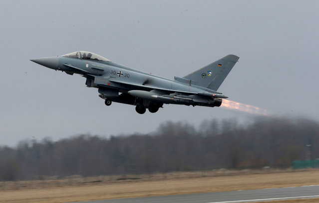 German Air Force Eurofighter Typhoon takes-off during the air policing scramble in Amari air base, Estonia, March 2, 2017. (Photo by Ints Kalnins/Reuters)