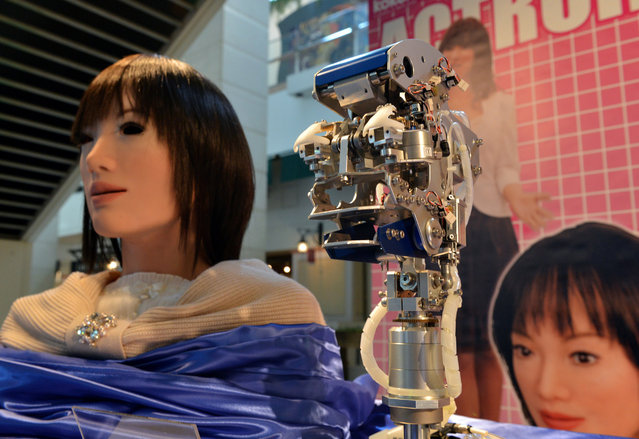 "Kokoro displays the company's humanoid robot called ""Actroid"" (left) and its internal workings (center) at Sanrio's headquarters in Tokyo, on February 7, 2013. (Photo by Yoshikazu Tsuno/AFP Photo)"