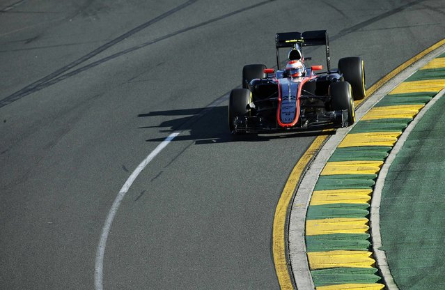 McLaren Formula One driver Jenson Button of Britain drives during the second practice session of the Australian F1 Grand Prix at the Albert Park circuit in Melbourne March 13, 2015.    REUTERS/Mark Dadswell