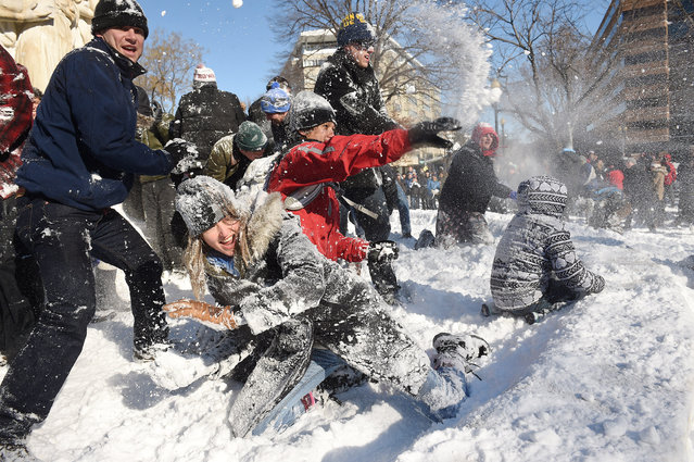 Tamberly Conway, bottom left, takes part in a large snowball fight in Dupont Circle on Sunday January 24, 2016 in Washington, DC. (Photo by Matt McClain/The Washington Post)