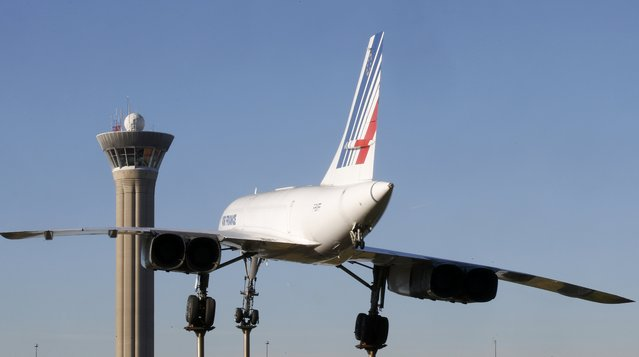 The retired Concorde number 5 is seen in front of the control tower at the Charles-de-Gaulle airport in Roissy on the eve of an air traffic controller's strike, near Paris, France, January 25, 2016. (Photo by Jacky Naegelen/Reuters)