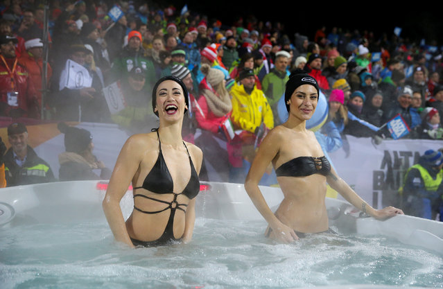 Alpine Skiing, FIS Alpine Skiing World Cup, Men's Parallel Giant Slalom, Alta Badia, Italy on December 19, 2016. Hostesses take a bath in a Jacuzzi pool during the race. (Photo by Stefano Rellandini/Reuters)