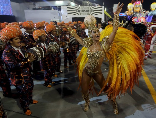 Revellers parade for Gavioes da Fiel samba school during carnival in Sao Paulo, Brazil, February 6, 2016. (Photo by Paulo Whitaker/Reuters)
