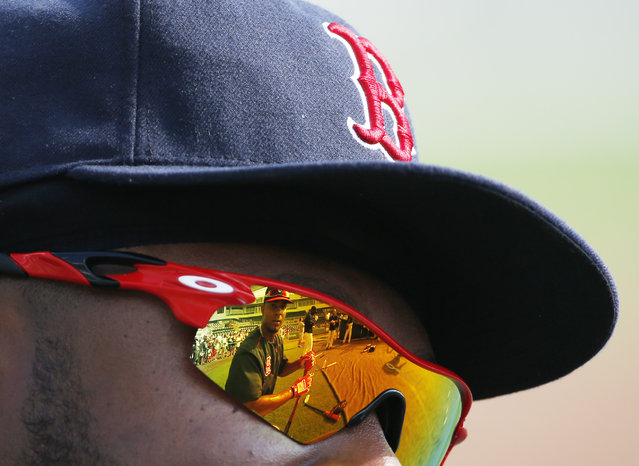 Boston Red Sox' Xander Bogaerts is reflected in teammate Hanley Ramirez's sunglasses before an exhibition spring training baseball game, Wednesday, March 18, 2015, in Fort Myers, Fla. (Photo by Brynn Anderson/AP Photo)