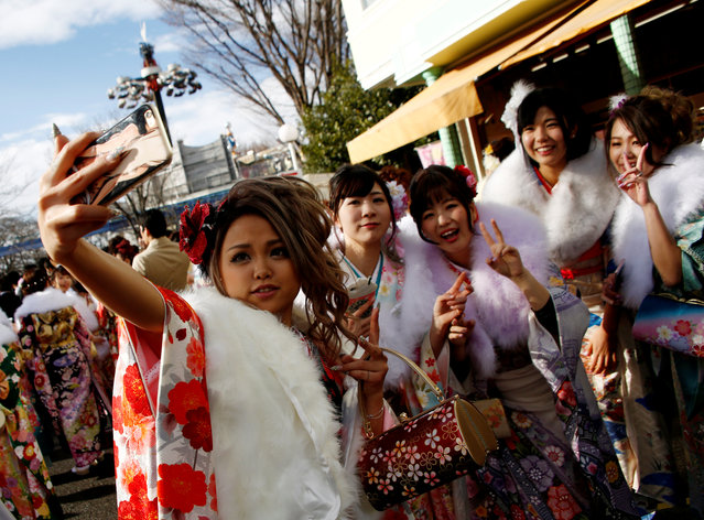 Japanese women wearing kimonos take a 'selfie' after their Coming of Age Day celebration ceremony at an amusement park in Tokyo, Japan January 9, 2017. (Photo by Kim Kyung-Hoon/Reuters)