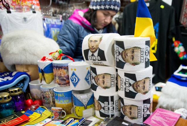 Toilet paper with images of Russian President Vladimir Putin printed on it is offered for sale at the Maidan Nezalezhnosti (lit. Independence Square) in Kiev, Ukraine on February 23, 2016. German foreign minister Frank-Walter Steinmeier and his French counterpart Jean-Marc Ayrault are continuing their joint visit to Ukraine, which is aimed at keeping the former Soviet republic on its path to pro-European reforms. (Photo by Kay Nietfeld/DPA via ZUMA Press)