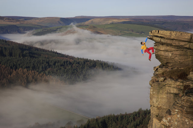 Mike Hutton hangs from Gargoyle Flake. (Photo by Mike Hutton/Caters News Agency)