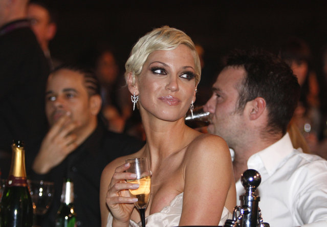 In this Wednesday, February 18, 2009 file photo, Singer Sarah Harding from British band Girls Aloud, attends the Brit Awards 2009 ceremony at Earls Court exhibition centre in London, England, Wednesday, Feb. 18, 2009. Harding, of British pop group Girls Aloud, has died after a battle with breast cancer, her mother said Sunday, Sept. 5, 2021. She was 39. The singer said last August that she had been diagnosed with breast cancer and it had spread to other parts of her body. (Photo by M.J. Kim/AP Photo/File)
