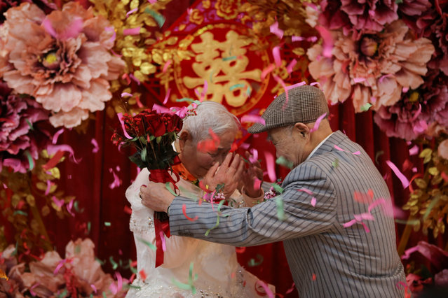An elderly couple attends a wedding ceremony that is recreated for them by local charities on their 70th wedding anniversary on Valentine's Day in Jiaxing, Zhejiang province, China on February 14, 2019. (Photo by Reuters/China Stringer Network)