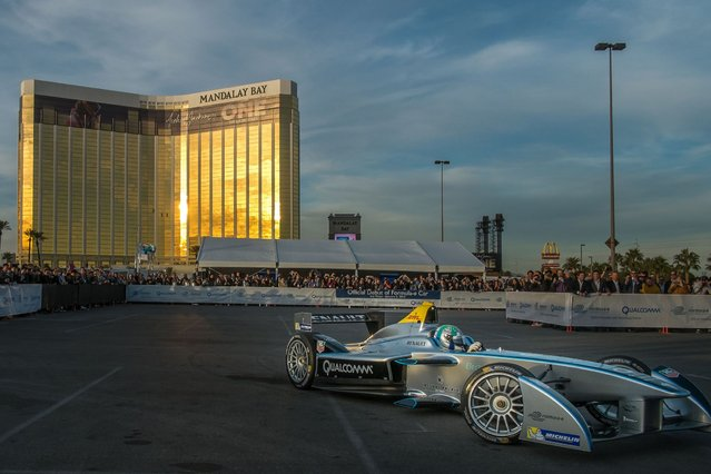 Official driver Lucas di Grassi demonstrates Formula E's new fully-electric race car, the Spark-Renault SRT_01E, entertaining crowds with a high-speed display around the Mandalay Bay Resort & Casino during the 2014 International CES on January 6, 2014 in Las Vegas, Nevada. (Photo by Joe Klamar/AFP Photo)