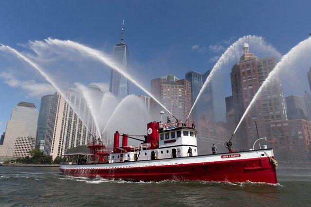 Marine flotilla commemorates the 20th anniversary of the September 11 attacks with boats at New York Harbor, New York, September 10, 2021.(Photo by Bjoern Kils/New York Media Boat via Reuters)