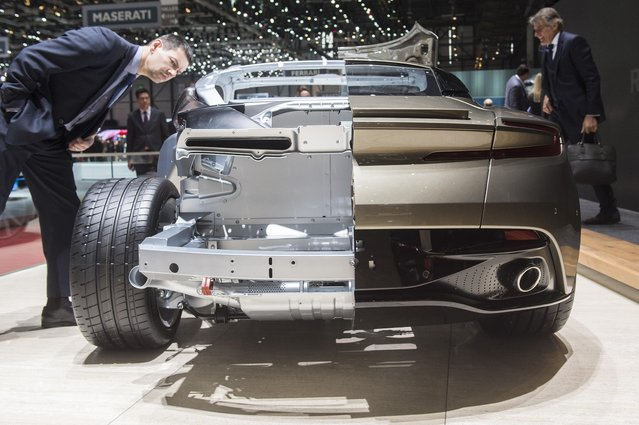 An Aston Martin cut out is presented during the second press day at the 86th International Auto Show in Geneva, Switzerland, Wednesday, March 2, 2016. The Auto Show will open its gates to the public from March 3 to 13, presenting more than 200 exhibitors and more than 120 world and European premieres. (Photo by Sandro Campardo/Keystone via AP Photo)