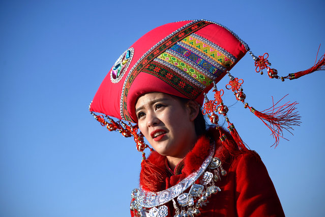 A hostess looks on at the Tiananmen Sqaure during the 2nd plenary session of the National People's Congress in Beijing on March 9, 2016. China's Communist-controlled parliament opened its annual session on March 5 and is expected to appove a new five-year plan to tackle slowing growth in the world's second-largest economy. (Photo by Wang Zhao/AFP Photo)