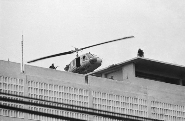 A U.S. Marine helicopter takes off from helipad on top of the American Embassy in Saigon, Vietnam, April 30, 1975. (Photo by AP Photo/Phuoc)