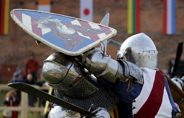 "A fighter from the U.S. clashes with his opponent from Lithuania during their ""5 vs 5"" competition at the Medieval Combat World Championship at Malbork Castle, northern Poland, April 30, 2015. (Photo by Kacper Pempel/Reuters)"