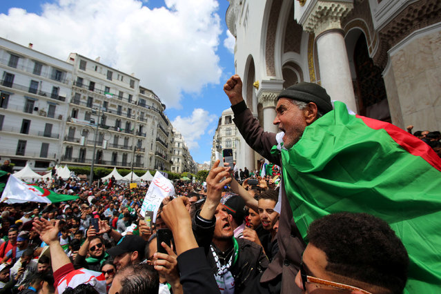 A man gestures during a protest against the appointment of interim president Abdelkader Bensalah demanding radical changes to the political system, in Algiers, Algeria on April 10, 2019. (Photo by Ramzi Boudina/Reuters)