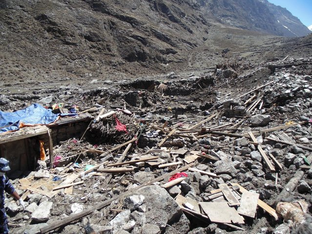 A general view of the aftermath of a massive avalanche triggered by last week's earthquake in Langtang village, Nepal, in this May 2, 2015 police handout photo. (Photo by Reuters)