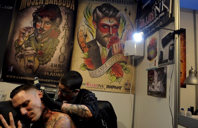 A man receives a tattoo during the Asturias Tatto Expo in Gijon, north of Spain, March 18, 2016. (Photo by Eloy Alonso/Reuters)