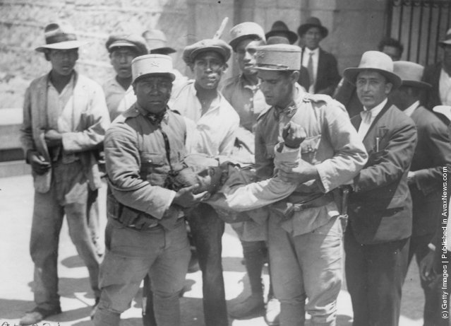 A group of men rescuing a wounded man in Peru, 1935