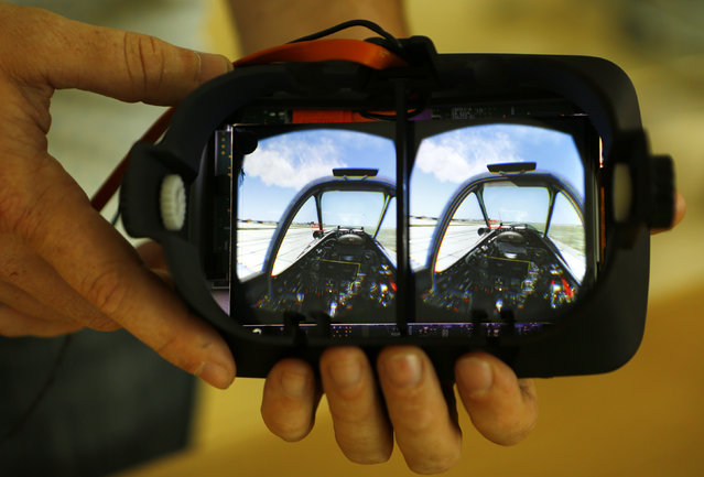 The stereoscopic view of an airplane cockpit is seen after the lenses are removed from a Vrvana virtual reality headset in Toronto September 12, 2014. (Photo by Chris Helgren/Reuters)
