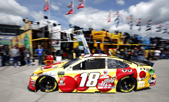 Driver Kyle Busch (18) pulls out of the garage area to practice for a NASCAR Cup Series auto race at Kansas Speedway in Kansas City, Kan., Friday, May 10, 2019. (Photo by Colin E. Braley/AP Photo)
