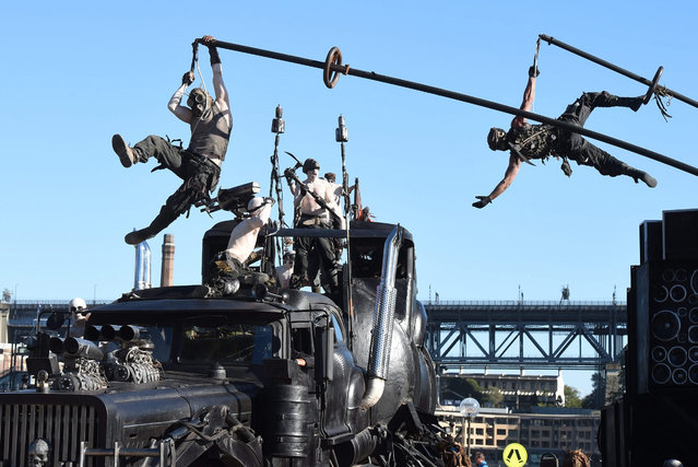 """Cast members from the new Mad Max movie, """"Mad Max – Fury Road"""",  film a promotion near the Sydney Opera House in Sydney, Australia, 13 May  2015. (Photo by Dean Lewins/EPA)"""