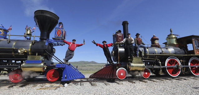 People re-created the historic photo of the meeting of the rails from May 10, 1869, during the commemoration of the 150th anniversary of the Transcontinental Railroad completion at the Golden Spike National Historical Park Friday, May 10, 2019, in Promontory, Utah. (Photo by Rick Bowmer/AP Photo)