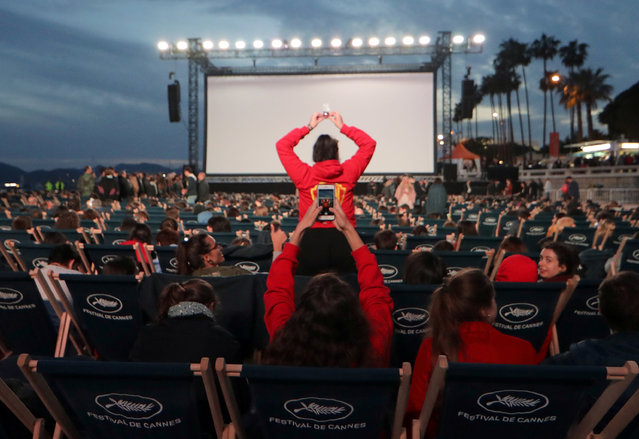 People gather to attend a beach front cinema screening at the 72nd edition of the Cannes Film Festival in Cannes, southern France, on May 16, 2019. (Photo by Eric Gaillard/Reuters)