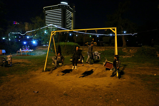 In this February 13, 2019 photo, children play at a park in Baghdad, Iraq. For the first time in years, Iraq is not at war. The defeat of the Islamic State group in late 2017 after a ruinous four-year conflict has given the population a moment of respite, and across the capital Baghdad there is a guarded sense of hope. (Photo by Khalid Mohammed/AP Photo)