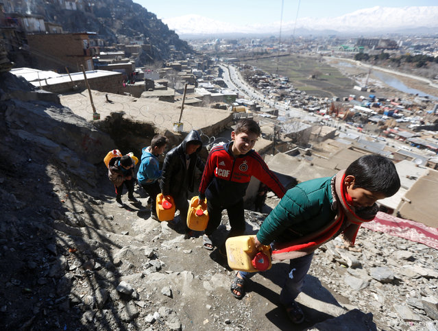 Afghan boys carry water as they climb a hill in Kabul, Afghanistan February 20, 2017. A growing population is straining water supplies in Afghanistan's capital, forcing those who can afford it to dig unregulated wells ever deeper to tap a falling water table. Finding water in arid Afghanistan is virtually always a challenge, but a drop in the groundwater level in Kabul caused by overuse and drought is making it even more difficult for residents, especially the poor. Modern Kabul was originally planned to support about 1 million people, but is now home to more than 4.6 million, according to U.S. government estimates, with people fleeing violence and seeking jobs thronging into urban centers. Several unseasonably dry winters, with little rain and a dusting of snow, have exacerbated the problem. Heavy rain and snow this year has raised hopes that groundwater can be replenished, at least for a while. Since 2001, Kabul's sprawl has expanded by nearly 2,500 square kilometers (965 square miles), according to the World Bank, with some of the poorest arrivals perched in homes on rocky hills around the city, where wells are generally non-existent. At the base of the hills, children cluster around hand-operated pumps, filling buckets and cans before climbing back up to their homes. People who can afford it usually dig a well rather than depending on the city's limited water system, but they are having to go ever deeper to reach the receding water. The depth of a well varies across the city, but Khan said many residents are being forced to dig 10 to 20 meters (32-64 feet) deeper than in the past. In some cases, wells have to go down 150 meters (492 feet) or more to reach clean water, at a cost of more than $5,200, he said, a price out of reach of many people. Officials say well digging has spiraled out of control, with little or no regulation of how the ever more scarce water is exploited. In the past, residents have been banned from digging wells within 100 meters (328 feet) of each other, but wells are now routinely dug 5 to 10 meters (16-32 feet) apart, sucking ever more water from the aquifers. The government was looking to implement a licensing system. The ministry of water and power did not respond to requests for comment. Poor residents are not optimistic authorities will get a grip on the problem, at least in a way that will help them get better access. (Photo by Omar Sobhani/Reuters)