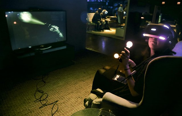 """In this Wednesday April 6, 2016, photo, Associated Press reporter Mae Anderson experiences playing the virtual reality horror game set """"Until Dawn: Rush of Blood"""", in New York. VR is clearly a medium in its infancy and creators are still devising new storytelling techniques that can exploit the technology's power. But it's impossible to deny the technology's underlying potential. (Photo by Bebeto Matthews/AP Photo)"""