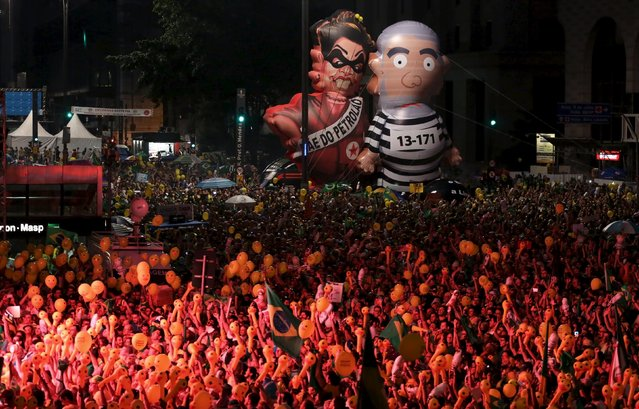"Inflatable dolls known as ""Pixuleco"" of Brazil's former president Luiz Inacio Lula da Silva (R) and Brazil's President Dilma Rousseff are seen as demonstrators look at on a big screen showing a session to review the request for Rousseff's impeachment in Brasilia, during a protest against her at Paulista Avenue in Sao Paulo, Brazil, April 17, 2016. (Photo by Nacho Doce/Reuters)"