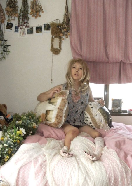 Born with a rare condition, the artist has chronicled her life in portraits – capturing everything from her tattooed prosthetics to the tentacled creature she stitched together on the shores of Naoshima. Katayama was born with tibial hemimelia, an extremely rare condition that stops bones in the lower legs from fully developing, often leaving them foreshortened. In her case, the condition also caused club feet and a cleft left hand that resembled a crab's pincers. Consequently, crab motifs recur in the work of the Japanese artist, who was also born under the sign of Cancer. Katayama is a star in the making, her work already attracting notice from collectors and curators in Europe and America – a rarity in the vibrant but insular world of Japanese contemporary art. Remarkably, Katayama never set out to be an artist. Her intricately embroidered and stuffed objects – inlaid with lace, seashells, hair, crystals and collaged images – were made purely for her own amusement. And art was far from her mind when she began to take portraits of herself. Here: In My Room (2009). An early self-portrait, taken in Katayama's childhood bedroom by her four-year old sister. (Photo by Mari Katayama/The Guardian)
