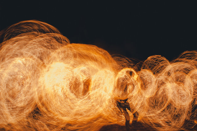 """""""Fire show at Kho Phi Phi"""". Main attraction on Kho Phi Phi island during the night on the beach. A lot of bars hire young people to realize fire shows and attract tourists in their bars. Photo location: Kho Phi Phi, Thailand. (Photo and caption by William Kerdoncuff/National Geographic Photo Contest)"""