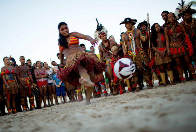 A native Brazilian kicks a soccer ball, during the Indigenous Youth Games of Pataxos nation in Santa Cruz de Cabralia, Bahia state, Brazil, April 17, 2016. (Photo by Roosevelt Cassio/Reuters)