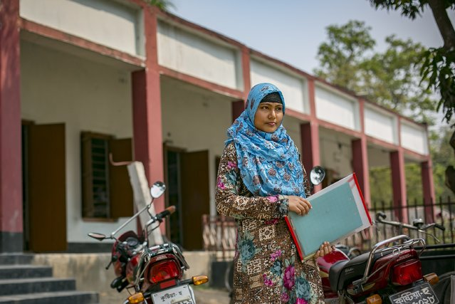 Rani stands outside a school before sitting for an exam March 6, 2017 in Khulna division, Bangladesh. (Photo by Allison Joyce/Getty Images)