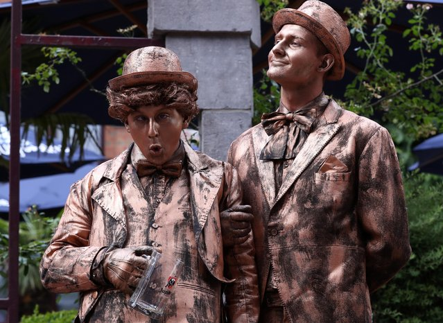"""Artists called """"Retour a la maison"""" takes part in the festival """"Statues en Marche"""" in Marche-en-Famenne, Belgium, July 20, 2019. (Photo by Yves Herman/Reuters)"""