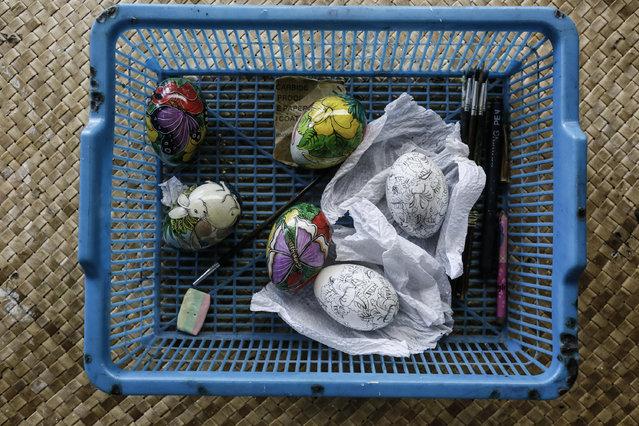 Finished and unfinish painted eggs at Wayan Sadra's workshop on April 14, 2014 in Sukawati, Gianyar, Bali, Indonesia. (Photo by Putu Sayoga/Getty Images)