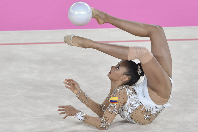 Colombian Oriana Vinas performs her routine in the Individual Rhythmic Gymnastics Ball Finals competition during the Lima 2019 Pan-American Games at the Villa El Salvador Sport Center in Lima on August 4, 2019. (Photo by Cris Bouroncle/AFP Photo)