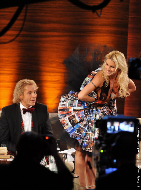 Michelle Hunziker presents a surprise dress to Thomas Gottschalk make out of pictures from his outfits during the 199th Wetten dass...? show