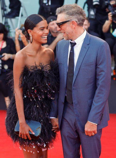 "Actor Vincent Cassel and his wife Tina Kunakey react on the red carpet for the screening of the film ""An Officer and a Spy"" during the 76th Venice Film Festival at Sala Grande on August 30, 2019 in Venice, Italy. (Photo by Yara Nardi/Reuters)"