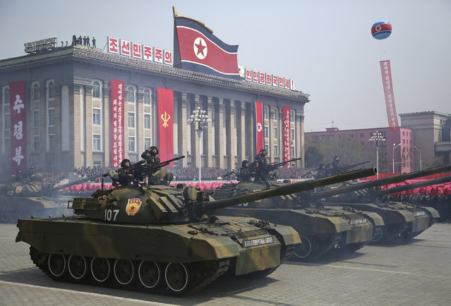 Soldiers in tanks take part in a military parade on Saturday, April 15, 2017, in Pyongyang, North Korea to celebrate the 105th birth anniversary of Kim Il Sung, the country's late founder and grandfather of current ruler Kim Jong Un. (Photo by Wong Maye-E/AP Photo)