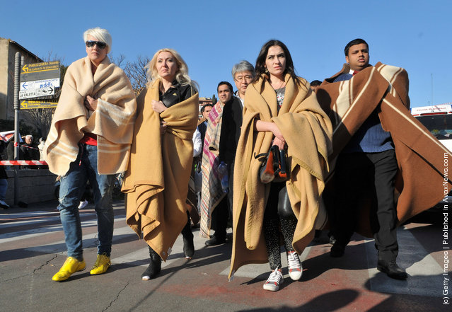 Crowds gather on the island of Giglio, where passengers aboard the cruise ship Costa Concordia have been staying after the vessel ran aground