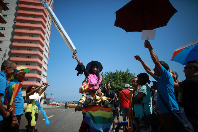 Gay rights activists are seen before the Annual March against Homophobia and Transphobia in Havana, May 14, 2016. (Photo by Alexandre Meneghini/Reuters)