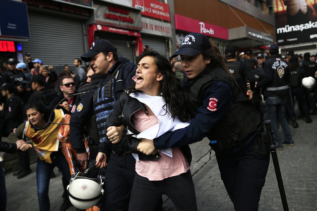 Police arrest demonstrators as they march during May Day, in Istanbul, Monday, May 1, 2017. Security forces prevented leftist groups trying to reach city's iconic Taksim Square to celebrate May Day. (Photo by Lefteris Pitarakis/AP Photo)