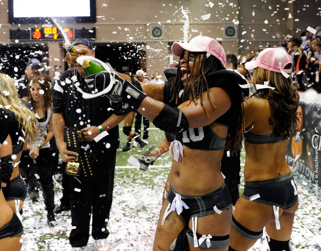Amber Reed #10 of the Los Angeles Temptation celebrates her team's 28-6 victory over the Philadelphia Passion to win the Lingerie Football League's Lingerie Bowl IX at the Orleans Arena