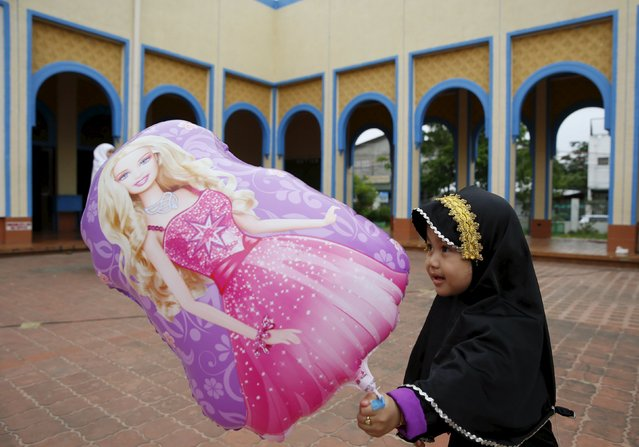A Filipino Muslim girl plays at the Blue Mosque during the Eid al-Fitr holiday, marking the end of the holy month of Ramadan in Taguig, Metro Manila in the Philippines July 17, 2015. (Photo by Erik De Castro/Reuters)