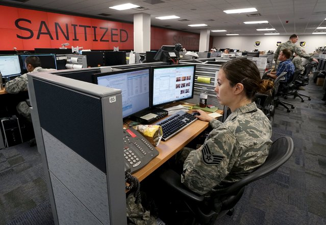 SSgt June Sterbank, Boundary Technician, works at the 561st Network Operations Squadron (NOS) at Petersen Air Force Base in Colorado Springs, Colorado July 20, 2015. The 561st NOS executes defensive cyber operations in response to U.S. Cyber Command orders and intelligence based threats. (Photo by Rick Wilking/Reuters)