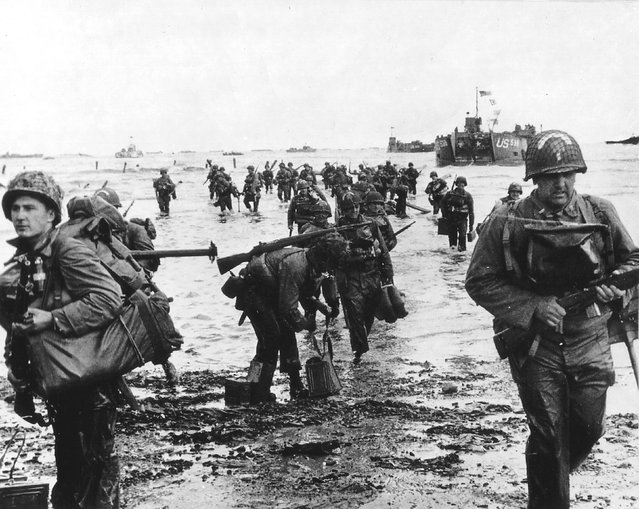 U.S. reinforcements land on Omaha beach during the Normandy D-Day landings near Vierville sur Mer, France, June 6, 1944. REUTERS/Cpt Herman Wall/US National Archives